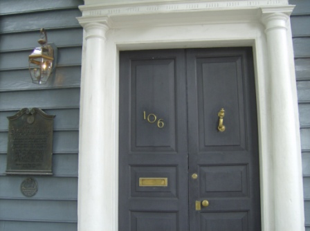 The front door with plaque to the left