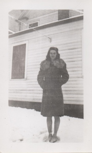 Here's my mom in a rare snowy setting.  This is perhaps at the house on Hill Street, next door to Miss Willie's house.