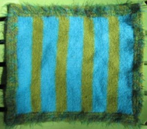 Finished mat, felted and dried, and it's not nearly as cute without a cat attached to it.