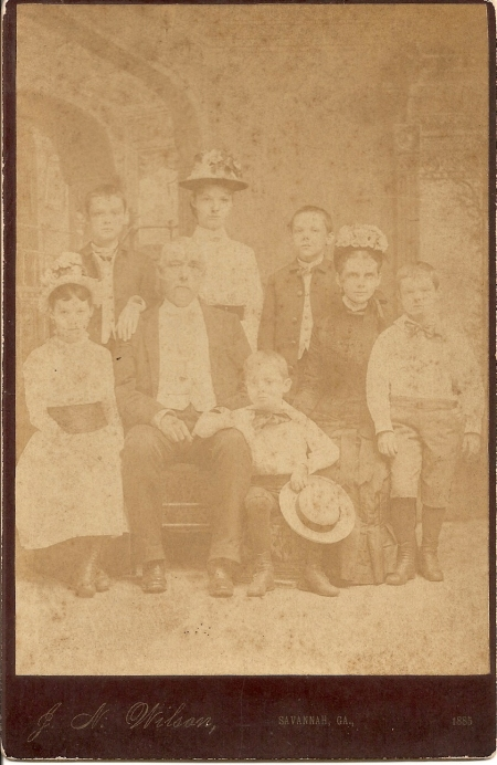 Back: Garnett, Mag, Will. Front: Leslie, Major Basinger, Walter, Mrs. Basinger, and Tom.