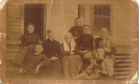"Mary ""Leslie"", Tom, Elizabeth ""Georgia"", Jane Susan Starr Basinger, Walter, Margaret Roane Garnett Basinger, Major William Starr Basinger, Maggie, and Ate' the dog in Dahlonega, Georgia."