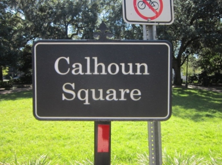 This sign faces north on the north side of the square.  Imagine that you are standing here, and the house on Taylor Street in behind you to your right and further down a bit.