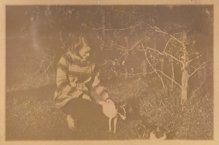 She had two wonderful dogs, Maggie and Jiggs. This was possibly made in the late fall of 1947. There are photos of the twins taken during this same photo session, and they look to be about 3-4 months old.
